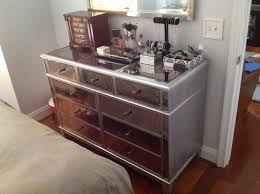 Silver Hayworth Vanity With Mirror Plus Makeup Tools And Bedding On Wooden Floor Matched Grey