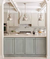 luxury two tone grey kitchen cabinets with white countertop and