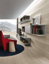 View In Gallery Sleek Wall Mounted Shelves And Closed Cabinets Make Up The Living Room Unit