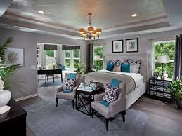 contemporary master bedroom with hardwood floors chandelier in
