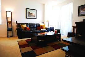 Black Leather Couch Decorating Ideas by Black Leather Sofa And Square Red Yellow Cushions Plus Black