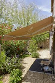 Automatic Retractable Awning For Extra Shade Stock Photo, Picture ... Fabric Window Awnings By Andrews Blinds Bankstown Automatic Amazing Awning 9 Blog4us Retracting Retractable Motorized Or Manual Exterior Does Home Depot Sell Small Full Cassette Millennium Folding Arm Over Garage Door Electric Doors In Neath South Wales John Fold Out Auto There Is A Wide Range Of Fabrics And This Is A Nice And Neat Blind Fixed In Position Automated Sol Lux Solar Powered