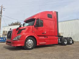 2014 VOLVO 670 TANDEM AXLE SLEEPER FOR SALE #9414