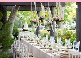 Country Fall Wedding Decorations Ideas With Hanging Lanterns Above Long Table And White Wooden Tables