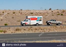 U-haul Cargo Truck Pulling Pickup On Tow Dolly In Southeastern Stock ... Uhaul About New Ownership At Picacho Self Storage Welcomes Arlington Food Express Trucks Trailers To Its Lot Study Texas Top State For Growth Third Year In Row Truck Urban Street Usa Stock Photo 552394 Alamy Using A Pickup Truck Moving Insider Filegmc Front Rearjpg Wikimedia Commons Dts Rv Aims To Increase Customers With Moving Trucks 43763923 Police 2 Stolen Wilmington 6abccom Similar Circumstances Surround N Charleston