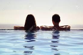 100 Infinity Swimming Young Couple Relaxing Together In An Pool And