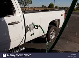 100 Diesel Truck Vs Gas Chevy Truck Filling Up With Diesel Fuel At Gas Station USA