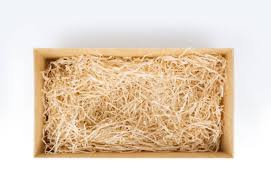 Open Gift Box With Decorative Straw Top View Stock Photo