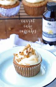 Delicious carrot cake cupcakes filled and topped with sweet cream cheese frosting