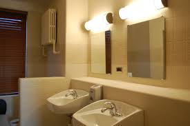 bathroom chic two single sink with mirrors also wall lights at