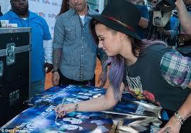 Demi Lovato is grunge chic in plaid rocker T shirt at My Big Night