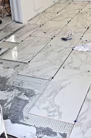 Laying marble tile bathroom floor
