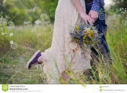 young healthy couple fashionable in a wedding dress guy in a