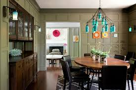 Green Walls Provide A Beautiful Backdrop For The Eclectic Dining Room Design LDa Architecture