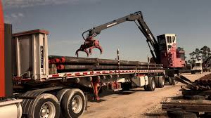 100 Crosby Trucking TRUCKING Unloading Pipe At AZ TerminalSooner Pipe Yard In
