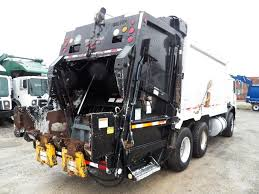 Garbage Trucks: Elliott Equipment Garbage Trucks