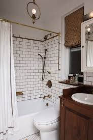 white tile wall and white fabric shower curtain on golden hook