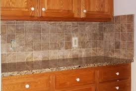 Kitchen Backsplash With Oak Cabinets by Tumbled Marble Backsplashes This Tumbled Marble Backsplash Look