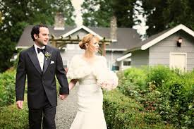 Groom And Bride Wearing White Fur Shrug Over Dress
