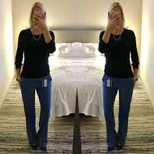 post black sweater blue trousers navy pumps
