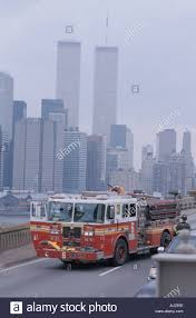 A New York Fire Truck The World Trade Center In The Background Stock ...