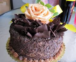 Dark chocolate cake with pink rose on top So pretty