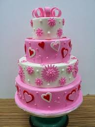 pink and white flowers heart wedding cake