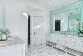white master bathroom with mint green tile backsplash