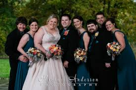 A Fall Color Wedding Photo Of The Bride Groom And Their Party Staying Dry