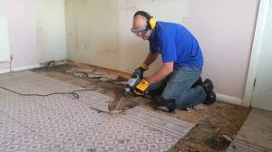 Drilling Through Ceramic Tile by Titan Sds With A 80mm Cranked Tile Chisel Removing A Kitchen Floor