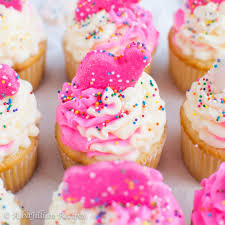 Fluffy White Cupcakes Filled With Creamy Animal Cookie Speckled Filling Topped A Pink