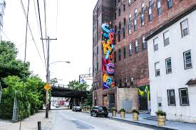 Philly Mural Arts Tour by New Glossblack Neighborhood Mural In Spring Arts Streets Dept