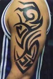 Bold Black Tribal Upper Arm Tattoo