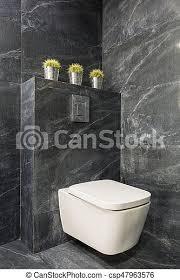 modernes graues badezimmer mit weißer toilette modernes
