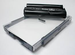 The Paper Tray And A Color Cartridge