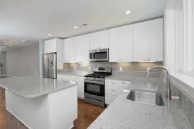 White Cabinets Dark Gray Countertops by Subway Tiles Kitchen Grey Subway Tile Backsplash Kitchen