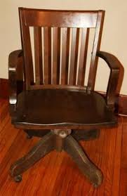 antique bankers oak rolling desk chair 1920s wood casters library