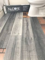 Vinyl Plank Flooring Thats Waterproof Lays Right On Top Of Your Existing Floor Love This Color Were Using In Our Bathroom Remodel