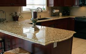Kitchens With Dark Cabinets And Light Countertops by New Venetian Gold Granite