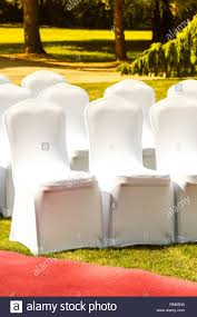 Many Wedding Chairs With White Elegant Covers On Green Grass ... Top 10 Most Popular White Lycra Wedding Chair Cover Spandex Decorations For Chairs At Weddingy Marvelous Chelsa Yoder Nicetoempty 6 Pcs Short Ding Room Chair Covers Stretch Removable Washable Protector For Home Party Hotel Wedding Ceremon Rentals Two Hearts Decor Cloth White Reataurant Outdoor Stock Photo Edit Now Summer Garden Civil Seating With Cotton Garden Civil Seating Image Of Cover Slipcovers Rose Floral Print Efavormart 40pcs Stretchy Spandex Fitted Banquet Luxury Salesa083 Buy Factorycheap Coversfancy Product On Alibacom