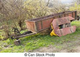 Old Farm Trailer In Harvested Field Stock Photographs
