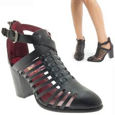 black closed toe buckle strappy cage ankle bootie chunky high heel