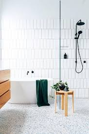 Vertical Tiles And A Terrazzo Floor With Blue Touches That Add Interest