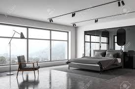corner of luxury master bedroom with white walls concrete floor