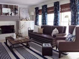 Home Decorating With Brown Couches by A Factory Cart Coffee Table And Reclaimed Barn Wood Hung Over The