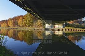 100 Water Bridge Germany Autumnal Light With The Shadow Of A Bridge