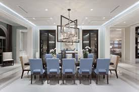 contemporary dining room with crown molding chandelier in lake