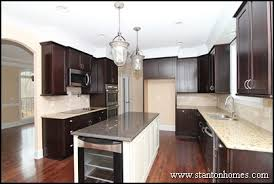 kitchens with floors light cabinets countertops and granite