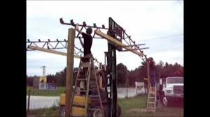 Setting Steel Pole Building Trusses - YouTube Home Steel Truss Pole Barns Vaulted Clearspan Web Buildings Northwest Llc Open Shelter And Fully Enclosed Metal Smithbuilt Barn Kit Prices Strouds Building Supply Decorations 84 Lumber Garage 30x40 Roof Beautiful Roof Trusses Wood How To Build A Pole Barn Garage Pinterest Used Prefab For Sale