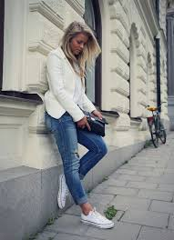 Picture Of An All White Look With Blue Distressed Jeans And Converse For Late Summer